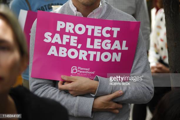 Abortion rights advocates rally to protest new restrictions on abortions, May 21 in West Hollywood, California. - Demonstrations were planned across...