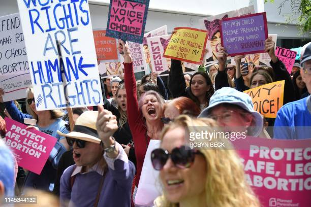 Abortion rights advocates rally to protest new restrictions on abortions May 21 in West Hollywood California Demonstrations were planned across the...