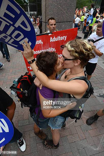 Abortion rights protesters Annah Shapiro and Kat Enyeart both from Portland Oregon kiss in front of street preacher Alan Hoyle on day two of the...