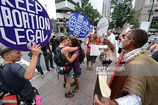 Abortion rights protestors Annah Shapiro and Kat Enyeart two women from Portland Oregon kiss in front of street preacher Alan Hoyle on day two of the...