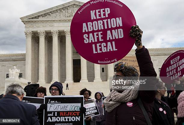 Abortion rights supporters and prolife supporters protest outside the US Supreme Court during the 44th annual March for Life on January 27 2017 in...