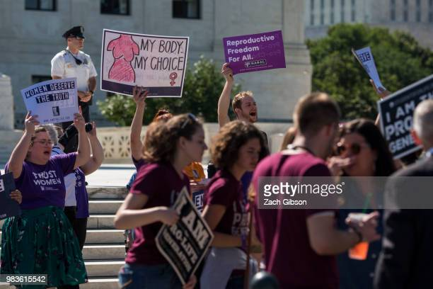 Abortion supporters and opponents hold signs in front of the US Supreme Court on June 25 2018 in Washington DC The high court is expected to issue...