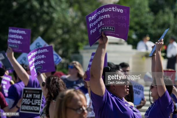 Abortion supporters hold signs in front of the US Supreme Court on June 25 2018 in Washington DC The high court is expected to issue decisions in six...
