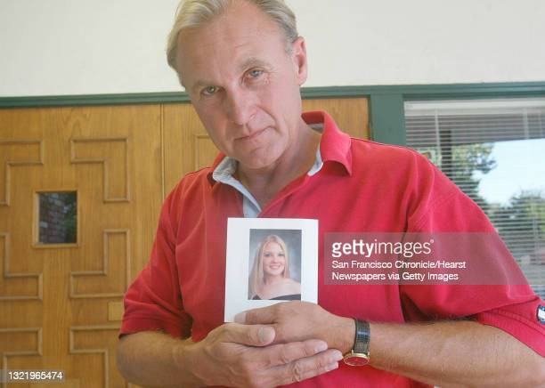 Abortion017_mac.jpg Monty Patterson of Livermore, holds a photgraph of his 18 year old daughter Holly who died Wednesday after taking the abortion...
