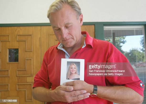 Abortion020_mac.jpg Monty Patterson of Livermore, holds a photgraph of his 18 year old daughter Holly who died Wednesday after taking the abortion...