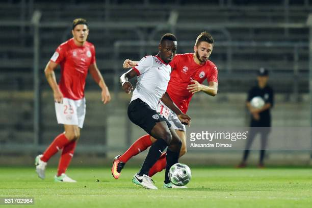 Abou Ba of Nancy and Theo Valls of Nimes during the Ligue 2 match between Nimes Olympique and As Nancy Lorraine at Stade des Costieres on August 14...