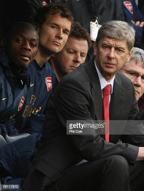 Abou Diaby and Jens Lehmann of Arsenal and manager Arsene Wenger look on from the bench during the Barclays Premier League match between Fulham and...
