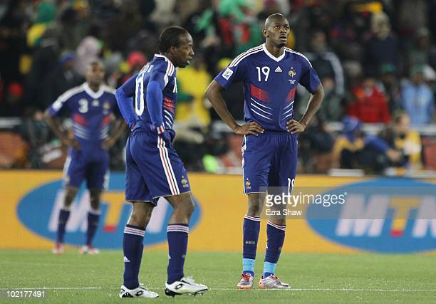 Abou Diaby and Sidney Govou of France look dejected following the first goal by Javier Hernandez of Mexico during the 2010 FIFA World Cup South...