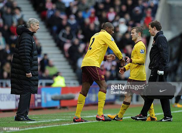 Abou Diaby comes on for Jack Wilshere of Arsenal as Arsenal Manager Arsene Wenger looks on during the Barclays Premier League match between...