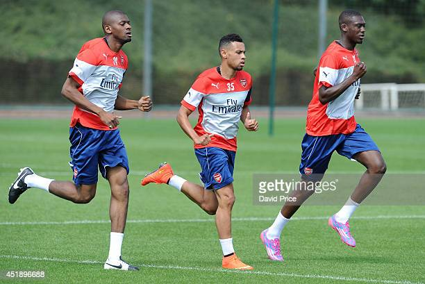 Abou Diaby Francis Coquelin and Yaya Sanogo of Arsenal during a training session at London Colney on July 9 2014 in St Albans England