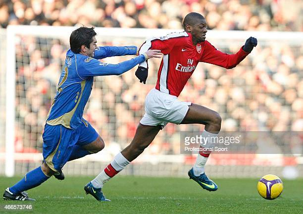 Abou Diaby of Arsenal and Richard Hughes of Porstmouth in action during the Barclays Premier League match between Arsenal and Portsmouth at the...