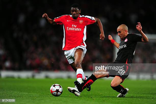Abou Diaby of Arsenal battles for the ball with Cristian Ledesma of Olympiakos during the UEFA Champions League Group H match between Arsenal and...