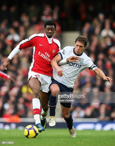 Abou Diaby of Arsenal battles for the ball with Stiliyan Petrov of Aston Villa during the Barclays Premier League match between Arsenal and Aston...