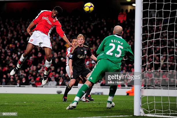 Abou Diaby of Arsenal heads the first goal of the game during the Barclays Premier League match between Arsenal and Liverpool at Emirates Stadium on...