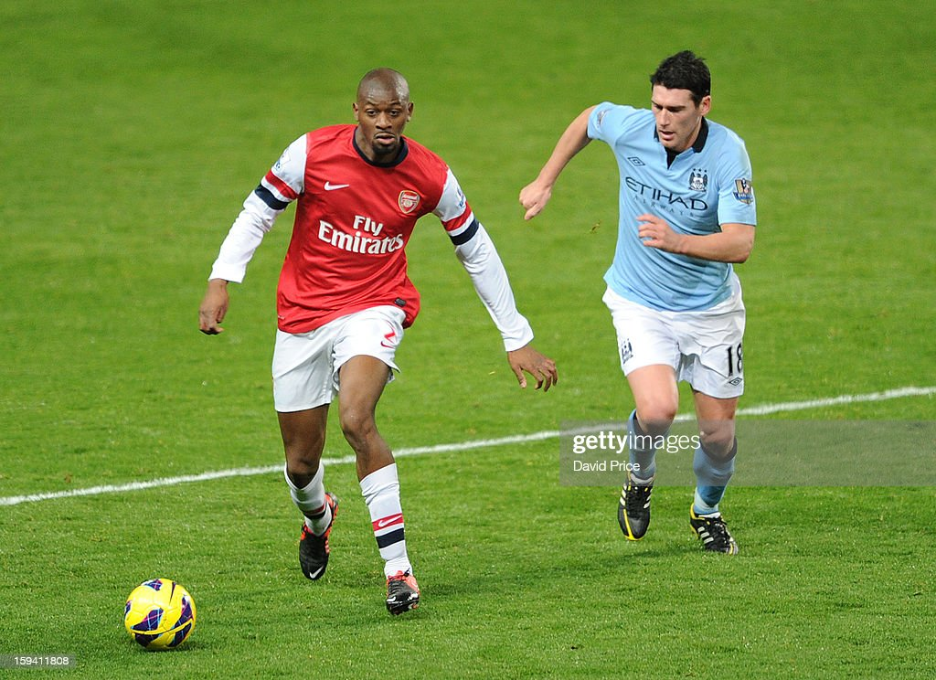 Abou Diaby of Arsenal takes on Gareth Barry of Manchester City during the Barclays Premier League match between Arsenal and Manchester City at Emirates Stadium on January 13, 2013 in London, England.