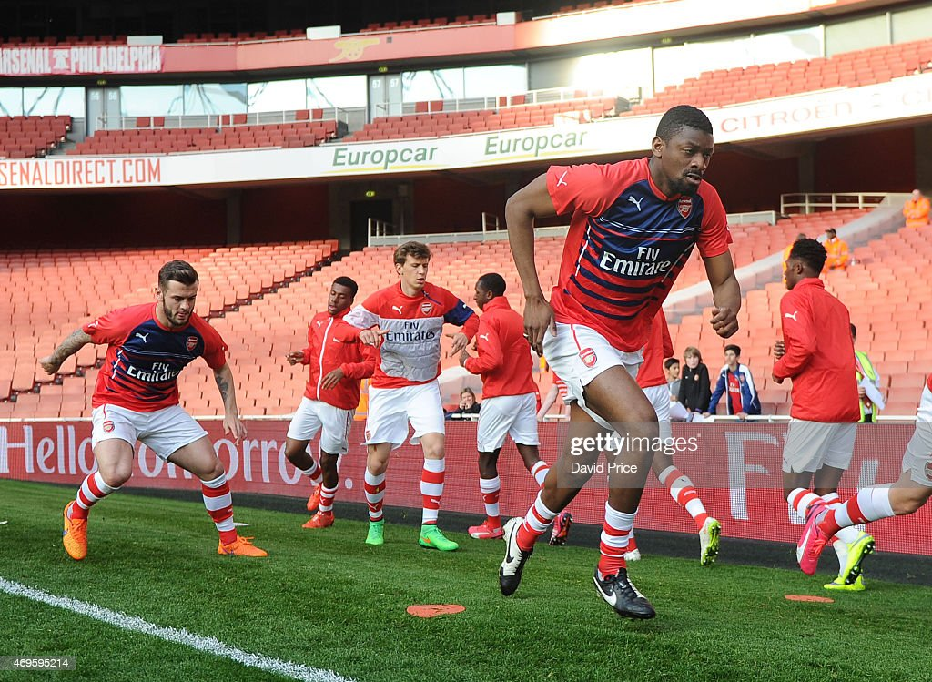 Abou Diaby of Arsenal warms up before the match between Arsenal U21 and Reading U21 in the Barclays Premier U21 League at Emirates Stadium on April 13, 2015 in London, England.