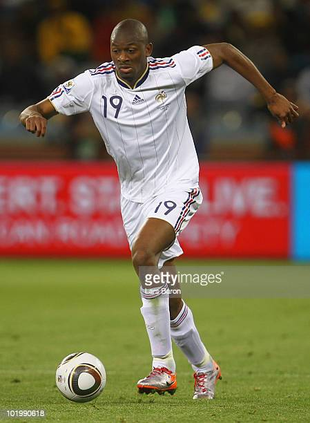 Abou Diaby of France runs with the ball during the 2010 FIFA World Cup South Africa Group A match between Uruguay and France at Green Point Stadium...