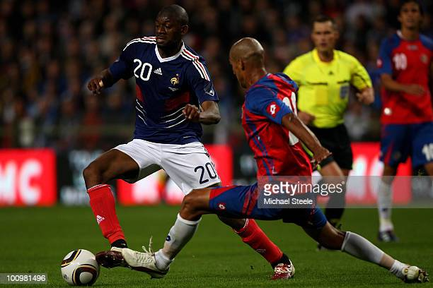 Abou Diaby of France sidesteps the challenge of Douglas Sequeira during the France v Costa Rica International Friendly match at Stade Felix Bollaert...