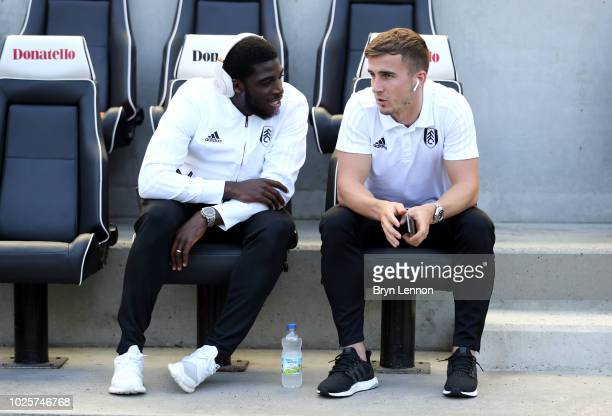 Aboubakar Kamara and Joe Bryan of Fulham speak ahead of the Premier League match between Brighton Hove Albion and Fulham FC at American Express...