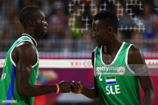 Aboubakar Kamara and Patrick Lombi of Leone Sierra celebrate a point against Seain Cook and Robin Miedzybrodzki of Scotland during the Mens Beach...