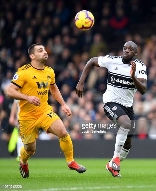Aboubakar Kamara of Fulham and Jonny Otto of Wolverhampton Wanderers chase after the ball during the Premier League match between Fulham FC and...