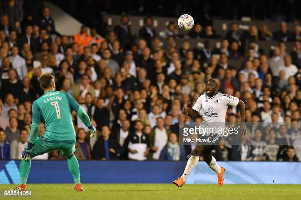 Aboubakar Kamara of Fulham and Scott Carson of Derby County in action during the Sky Bet Championship Play Off Semi Final second leg match between...