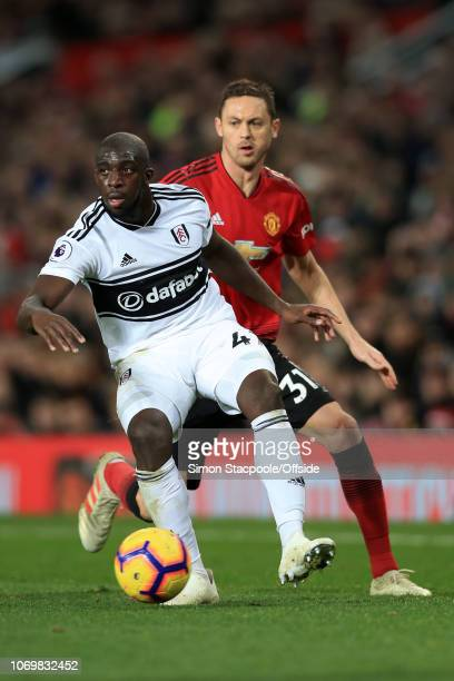 Aboubakar Kamara of Fulham battles with Nemanja Matic of Man Utd during the Premier League match between Manchester United and Fulham at Old Trafford...