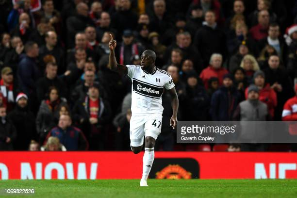 Aboubakar Kamara of Fulham celebrates after scoring his team's first goal from a penalty during the Premier League match between Manchester United...