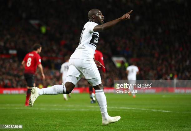 Aboubakar Kamara of Fulham celebrates after scoring his team's first goal during the Premier League match between Manchester United and Fulham FC at...