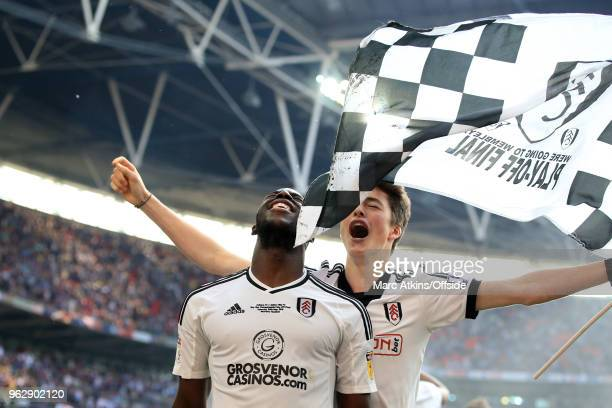 Aboubakar Kamara of Fulham celebrates with a fan during the Sky Bet Championship Play Off Final between Aston Villa and Fulham at Wembley Stadium on...