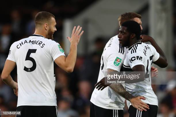 Aboubakar Kamara of Fulham celebrates with his team mates after scoring his team's first goal during the Carabao Cup Second Round match between...