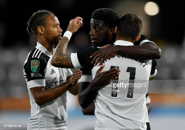 Aboubakar Kamara of Fulham celebrates with teammates after scoring his sides first goal during the Carabao Cup third round match between Fulham and...