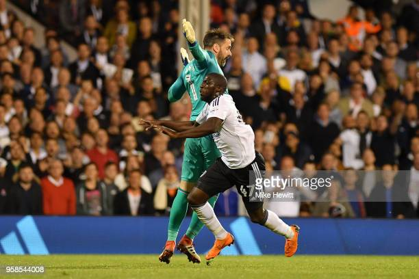 Aboubakar Kamara of Fulham clashes with Scott Carson of Derby County during the Sky Bet Championship Play Off Semi Final second leg match between...