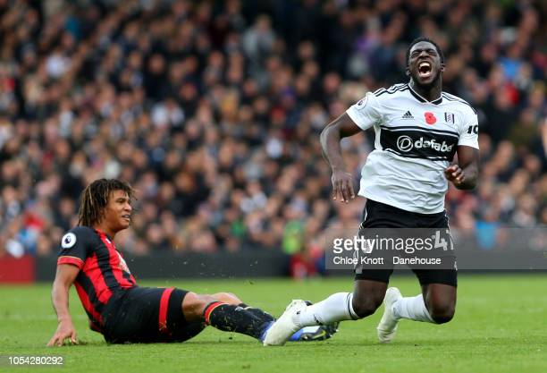 Aboubakar Kamara of Fulham goes down after a challenge from Nathan Ake of Bournemouth during the Premier League match between Fulham FC and AFC...