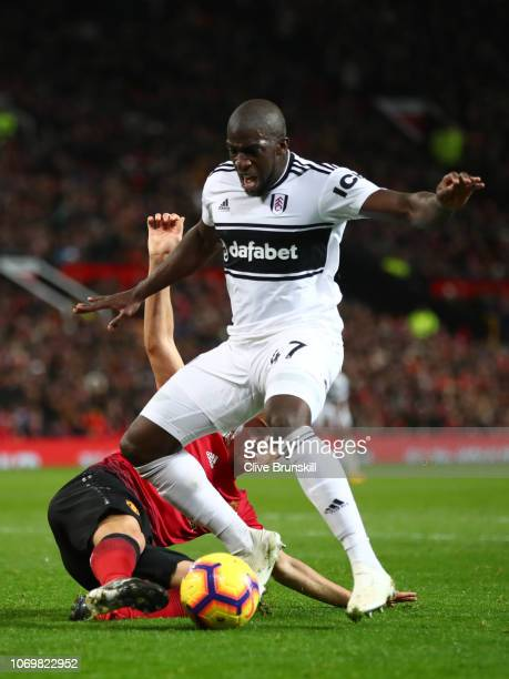 Aboubakar Kamara of Fulham is challenged by Ander Herrera of Manchester United which leads to a penalty during the Premier League match between...