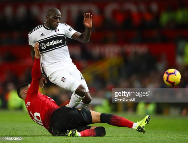Aboubakar Kamara of Fulham is challenged by Marcos Rojo of Manchester United during the Premier League match between Manchester United and Fulham FC...