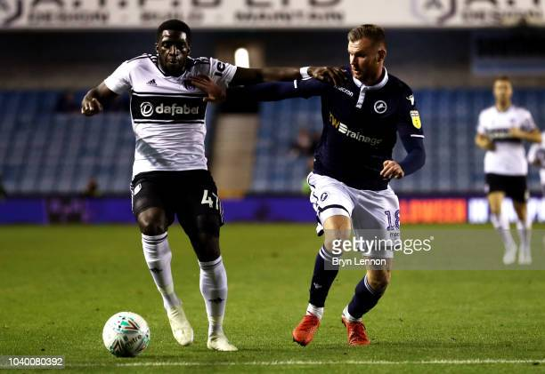 Aboubakar Kamara of Fulham is challenged by Ryan Tunnicliffe of Millwall during the Carabao Cup Third Round match between Millwall and Fulham at The...