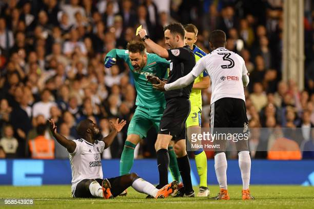Aboubakar Kamara of Fulham is shown a yellow card by referee Chris Kavanagh during the Sky Bet Championship Play Off Semi Final second leg match...