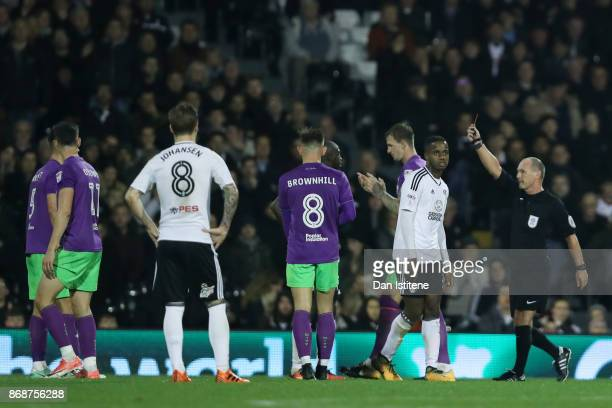 Aboubakar Kamara of Fulham is shown the red card by referee Scott Duncreferee Roger Eastduring the Sky Bet Championship match between Fulham and...