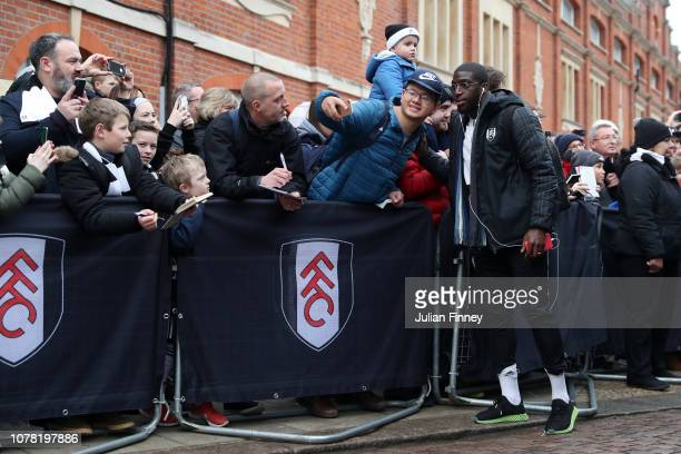 Aboubakar Kamara of Fulham pose for a photo with a fan as he arrives at the stadium prior to the FA Cup Third Round match between Fulham and Oldham...
