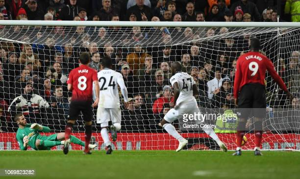 Aboubakar Kamara of Fulham scores his team's first goal from a penalty during the Premier League match between Manchester United and Fulham FC at Old...