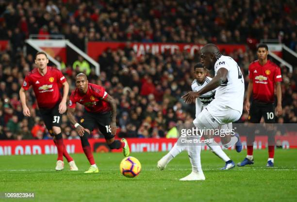Aboubakar Kamara of Fulham scores his team's first goal from the penalty spot during the Premier League match between Manchester United and Fulham FC...