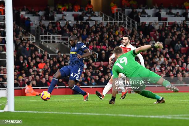 Aboubakar Kamara of Fulham scores his team's first goal past Bernd Leno of Arsenal during the Premier League match between Arsenal FC and Fulham FC...