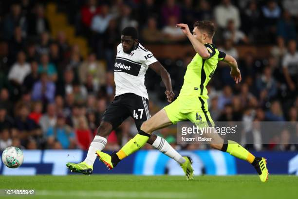 Aboubakar Kamara of Fulham scores his team's second goal past Dara O'Shea of Exeter City during the Carabao Cup Second Round match between Fulham and...