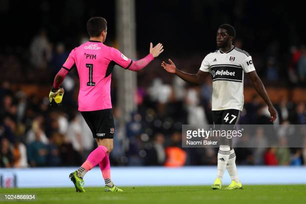 Aboubakar Kamara of Fulham shakes hands with Christy Pym of Exeter City after the Carabao Cup Second Round match between Fulham and Exeter City at...