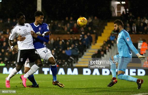 Aboubakar Kamara of Fulham shoots on goal under pressure from Jordan Spence of Ipswich during the Sky Bet Championship match between Fulham and...