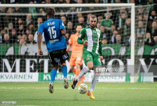 Aboubakar Keita of Halmstad BK and Kennedy Bakircioglu of Hammarby IF during the Allsvenskan match between Hammarby IF and Halmstad BK at Tele2 Arena...
