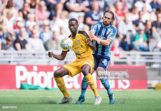 Aboubakar Keita of Halmstad BK and Kevin Walker of Djurgardens IF under the Allsvenskan match between Djurgardens IF and Halmstad BK at Tele2 Arena...