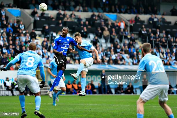 Aboubakar Keita of Halmstad BK and Markus Rosenberg of Malmo FF during the Allsvenskan match between Malmo FF and Halmstads BK at Swedbank Stadion on...