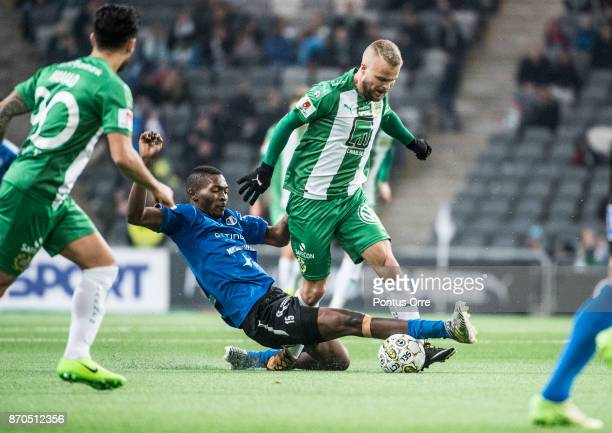 Aboubakar Keita of Halmstad BK and Sander Svendsen of Hammarby IF during the Allsvenskan match between Hammarby IF and Halmstad BK at Tele2 Arena on...